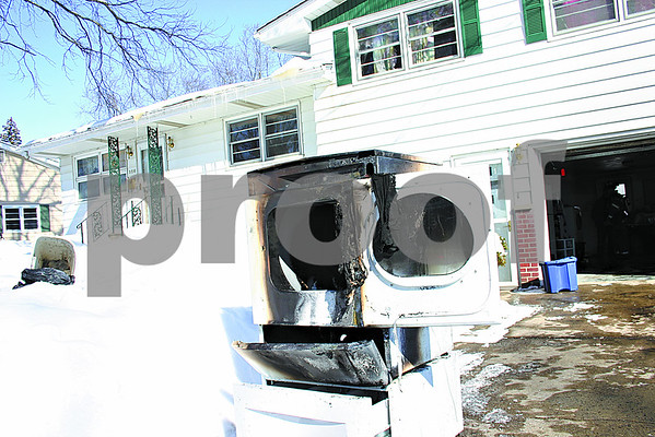 After this dryer caught fire in a garage in the 300 block of Crescent Street in Sycamore Tuesday afternoon, firefighters were able to keep the fire from spreading so that no damage was done to the home.