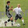 Rob Winner – rwinner@shawmedia.com<br /> <br /> Kaneland's Arsim Azemi (3) and Sycamore's Adam Millburg try to control a ball during the first half in Sycamore, Ill., on Tuesday, Sept. 27, 2011. Kaneland defeated Sycamore, 2-0.
