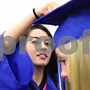 Kyle Bursaw – kbursaw@daily-chronicle.com<br /> <br /> Arcenia Troutman helps fellow Hinckley-Big Rock senior Emily Stege adjust her cap before the graduation ceremony on Sunday, May 29, 2011.