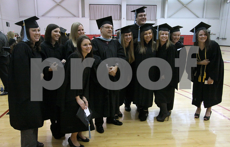 Wendy Kemp - For The Daily Chronicle<br /> The Special Education graduates pose for a picture before the graduation ceremony at Northern Illinois University on Sunday.<br /> DeKalb 12/11/11