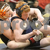 Kyle Bursaw – kbursaw@daily-chronicle.com<br /> <br /> Kaneland's Nick Michels wraps up Cary-Grove's Collin Hansen during a 171 pound weight class match at Sycamore high school on Saturday, Jan. 8, 2011.