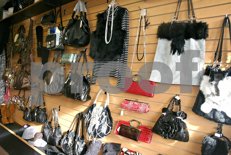 Specialty Gifts opened its doors about two weeks ago in downtown Genoa. All accessories, shoes and clothing in the gift shop is on sale for less than $40.<br /> <br /> By NICOLE WESKERNA - nweskerna@shawmedia.com