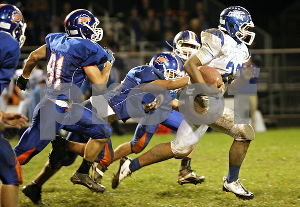 Rob Winner – rwinner@shawmedia.com<br /> <br /> Burlington Central's Joel Bouagnon carries the ball for a rushing touchdown during the second quarter in Genoa, Ill. on Friday, Sept. 30, 2011.