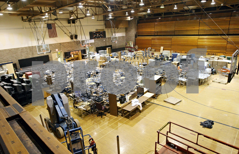 Rob Winner – rwinner@daily-chronicle.com<br /> <br /> The gymnasium at the new Huntley Middle School is filled with items such as desks, book cases and televisions as construction work continues within the classrooms.