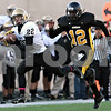 Rob Winner – rwinner@shawmedia.com<br /> <br /> Sycamore's Davey Scholz (22) hauls in a Ryan Bartels pass as King's Nathaniel Powell (12) trails during the second quarter of a Class 5A playoff game in Chicago on Saturday, October 29, 2011. Sycamore defeated King, 36-29.