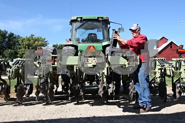 Rob Winner – rwinner@shawmedia.com<br /> <br /> John Hintzsche works on a piece of equipment as Schweitzer Farms in Malta begin preparing for the upcoming harvest on Thursday, Sept. 15, 2011.