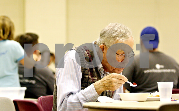 Rob Winner – rwinner@daily-chronicle.com<br /> <br /> Retired pastor Howard W. Jacobson sits down for a meal provided by Feed'Em Soup at the First Lutheran Church of DeKalb on Friday October 13, 2010.