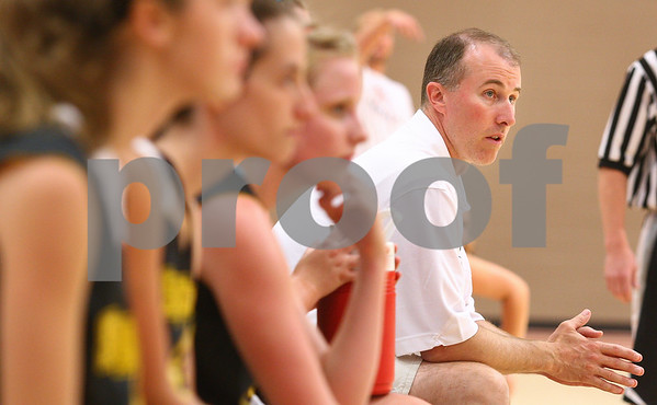 Kyle Bursaw – kbursaw@daily-chronicle.com<br /> <br /> Sycamore Girls Basketball coach Brett Goff looks on at the game action from the bench during a summer league game at the new DeKalb High School on Wednesday, July 6, 2011.