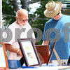 Kyle Bursaw – kbursaw@daily-chronicle.com<br /> <br /> Brothers Bob (left) and Jim Self look at silent auction items. Jim bid on a restaurant gift certificate and Bob was a volunteer at Meet me at the Fair, a fundraiser for the Pay-It-Forward House in Sycamore, Ill. on Saturday, July 16, 2011.