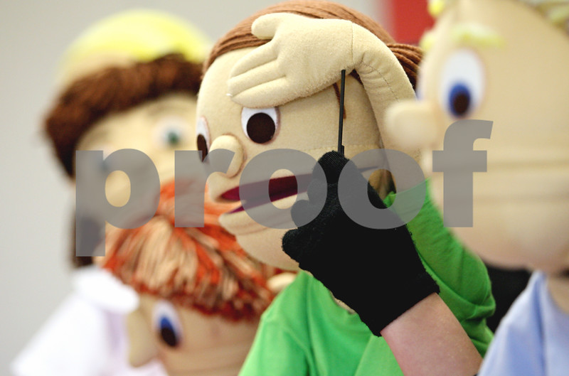 """Rob Winner – rwinner@daily-chronicle.com<br /> <br /> Sycamore High School students perform a disability awareness puppet show called """"Kids on the Block,"""" which deals with autism and Down Syndrome, to students at North Prairie Elementary in Sycamore on Monday afternoon."""