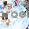 Kyle Bursaw – kbursaw@daily-chronicle.com<br /> <br /> Toni Leal, a social worker with Community Coordinated Child Care, adds more shaving cream to a pool for kids to play in outside the DeKalb Public Library during the Silly Summer Fun event on Wednesday, Aug. 3, 2011.