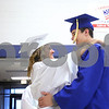 Kyle Bursaw – kbursaw@daily-chronicle.com<br /> <br /> Somonauk Community High School seniors Molly Bunkofske and William Passero dance in the cafeteria while waiting for their graduation ceremony to begin at the school on Sunday, May 29, 2011.