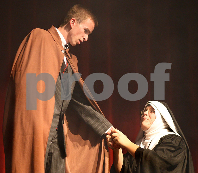 Kyle Bursaw – kbursaw@shawmedia.com<br /> <br /> Sister Agnes, played by Allison Duffin (kneeling), speaks with Jonathan Harker, played by  Dalton Bates, during a dress rehearsal of Dracula at DeKalb High School on Monday, Oct. 31, 2011.