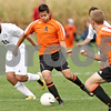Rob Winner – rwinner@shawmedia.com<br /> <br /> DeKalb's Johnny Franco (4) moves the ball during the first half in Maple Park on Thursday, Sept. 29, 2011.