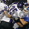Rob Winner – rwinner@shawmedia.com<br /> <br /> Genoa-Kingston running back Jose Ruiz (23) is tackled for a loss by Rockford Lutheran safety Spencer Kosch (35) during the first quarter in Genoa Friday, Aug. 31, 2012.