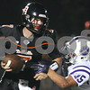 Kyle Bursaw – kbursaw@shawmedia.com<br /> <br /> DeKalb quarterback Jack Sauter escapes the grasp of Hampshire's Nicholas Kielbasa during the second quarter of the game at DeKalb High School on Friday, Aug. 31, 2012.