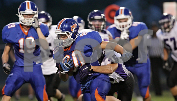 Rob Winner – rwinner@shawmedia.com<br /> <br /> Genoa-Kingston running back Sal Lopez (80) is tackled by Rockford Lutheran safety Spencer Kosch (35) during the first quarter in Genoa Friday, Aug. 31, 2012.