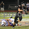 Kyle Bursaw – kbursaw@shawmedia.com<br /> <br /> DeKalb wide receiver Drew Paszotta runs past a pair of Hampshire defenders on his way to a second quarter touchdown putting the Barbs up 14-7 at DeKalb High School on Friday, Aug. 31, 2012.