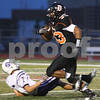 Kyle Bursaw – kbursaw@shawmedia.com<br /> <br /> DeKalb running back Dre Brown blows past Hampshire's Ryan Cork early in the first quarter to put the Barbs up 7-0 at DeKalb High School on Friday, Aug. 31, 2012.