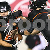 Kyle Bursaw – kbursaw@shawmedia.com<br /> <br /> DeKalb quarterback Jack Sauter fakes a handoff to Dylan Hottsmith during the first quarter of the annual DeKalb-Sycamore football game at Huskie Stadium on Friday, Sept. 7, 2012.