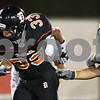 Kyle Bursaw – kbursaw@shawmedia.com<br /> <br /> DeKalb running back Dre Brown tries to power through Sycamore defenders including John Beaudoin (74) during the second quarter of the annual DeKalb-Sycamore football game at Huskie Stadium on Friday, Sept. 7, 2012.