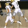 Kyle Bursaw – kbursaw@shawmedia.com<br /> <br /> Sycamore's David Compher gives teammate Ben Niemann a congratulatory pat on the head after Niemann scored the Spartan's second touchdown putting them up 14-0 against during the second quarter of the annual DeKalb-Sycamore football game at Huskie Stadium on Friday, Sept. 7, 2012.