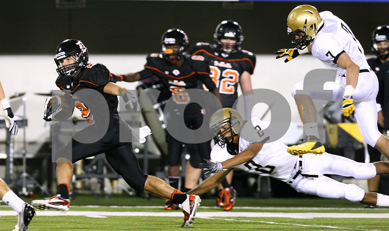 Kyle Bursaw – kbursaw@shawmedia.com<br /> <br /> DeKalb's Dylan Hottsmith outpaces Sycamore defenders Dylan Foster (2) and Michael Stinnett (7) during the first quarter of the annual DeKalb-Sycamore football game at Huskie Stadium on Friday, Sept. 7, 2012.
