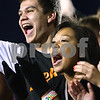 Kyle Bursaw – kbursaw@shawmedia.com<br /> <br /> DeKalb seniors Devon Farrell and Jurnee Iverson cheer for the Barbs in the student section before the annual DeKalb-Sycamore football game at Huskie Stadium on Friday, Sept. 7, 2012.