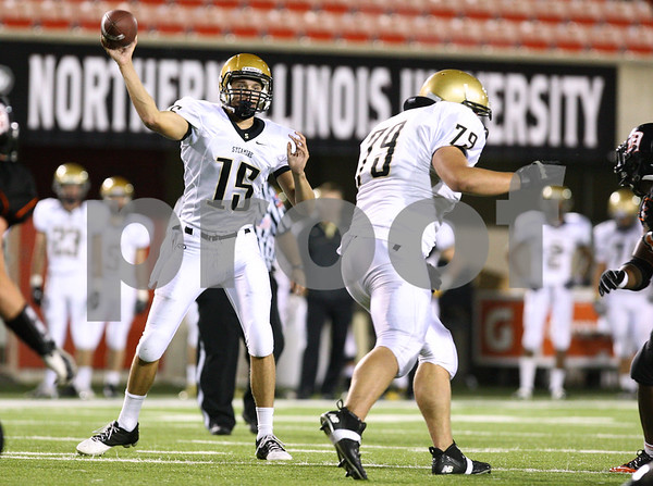 Kyle Bursaw – kbursaw@shawmedia.com<br /> <br /> Sycamore quarterback Devin Mottet fires off a pass during the first quarter of the annual DeKalb-Sycamore football game at Huskie Stadium on Friday, Sept. 7, 2012.