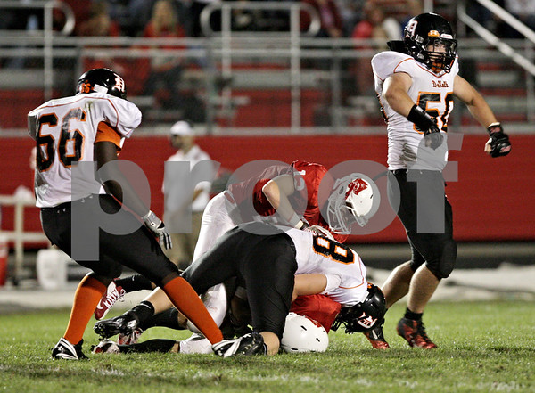 Rob Winner – rwinner@shawmedia.com<br /> <br /> DeKalb linebacker Clayton Mosher (right) celebrates his sack of Ottawa quarterback William Hoffman late during the second quarter in Ottawa on Friday, Sept. 14, 2012.