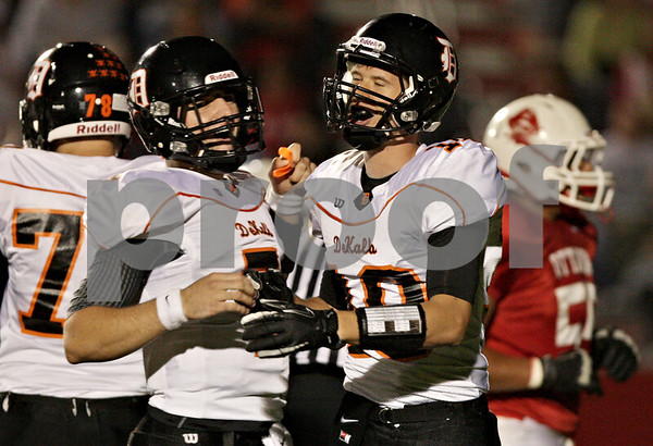 Rob Winner – rwinner@shawmedia.com<br /> <br /> DeKalb quarterback Jack Sauter (left) and wide receiver Jake Carpenter celebrate their 22-yard touchdown pass play in the second quarter in Ottawa on Friday, Sept. 14, 2012.