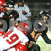 Kyle Bursaw – kbursaw@shawmedia.com<br /> <br /> DeKalb wide receiver Jake Carpenter fights for extra yardage while being tackled by Streator's Ryan Bresnahan in the second quarter of the game at DeKalb High School on Friday, Sept. 21, 2012.