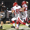 Kyle Bursaw – kbursaw@shawmedia.com<br /> <br /> DeKalb quarterback Jack Sauter breaks away from Streator defenders including Travis Sauers (85) and Joe Davis (32)  for a touchdown putting the Barbs up 12-0 in the first quarter of the game at DeKalb High School on Friday, Sept. 21, 2012.