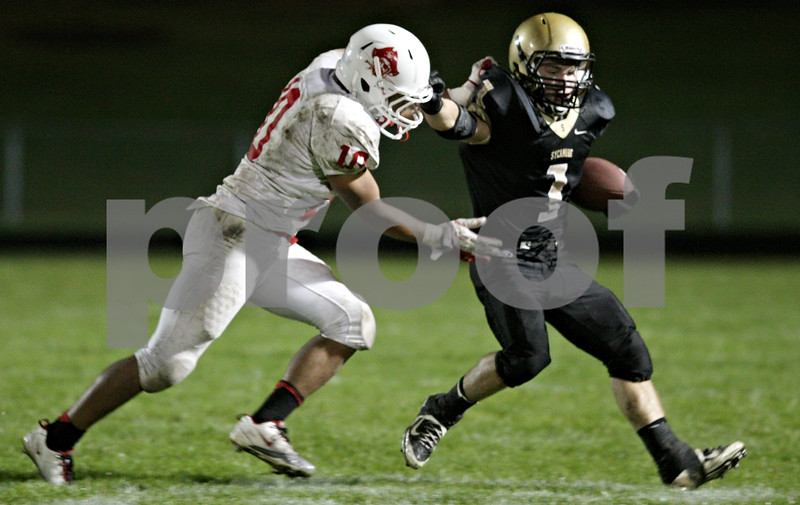 Rob Winner – rwinner@shawmedia.com<br /> <br /> Ottawa linebacker Miguel Hermosillo (10) forces Sycamore running back Austin Culton (1) out-of-bounds just before the end of the first half in Sycamore Friday, Sept. 21, 2012.