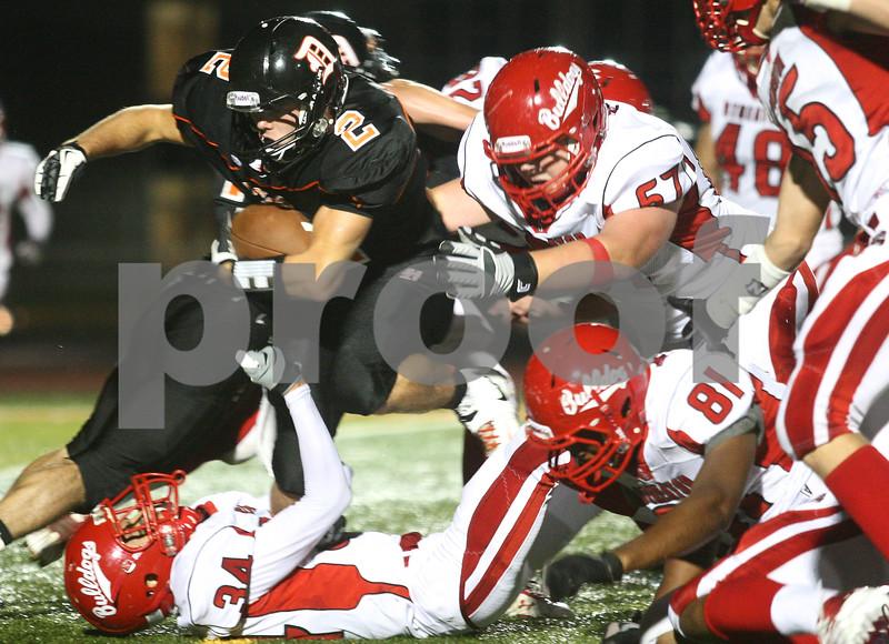 Kyle Bursaw – kbursaw@shawmedia.com<br /> <br /> DeKalb's Dylan Hottsmith pushes forward against Streator defenders in the first quarter of the game at DeKalb High School on Friday, Sept. 21, 2012.