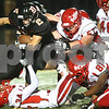 Kyle Bursaw – kbursaw@shawmedia.com<br /> <br /> DeKalb's Dylan Hottsmith pushes forward against Streator defenders in the first quarter of the game at DeKalb High School on Friday, Sept. 21, 2012.