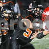 Kyle Bursaw – kbursaw@shawmedia.com<br /> <br /> DeKalb's Javi Montalvo gets a block from offensive lineman Brandon Olson in the second quarter of the game at DeKalb High School on Friday, Sept. 21, 2012.