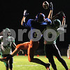 Kyle Bursaw – kbursaw@shawmedia.com<br /> <br /> Genoa-Kingston's Mike Kuhn hauls in a touchdown over North Boone's Brandon Briggs to put the Cogs up 7-0 in the first quarter of the game against North Boone at Genoa-Kingston High School on Friday, Oct. 5, 2012.