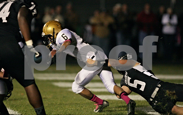 Rob Winner – rwinner@shawmedia.com<br /> <br /> Sycamore running back Dion Hooker (6) is tackled by Kaneland linebacker Gary Koehring (5) in the end zone for a safety during the first quarter in Maple Park Friday, Oct. 12, 2012.