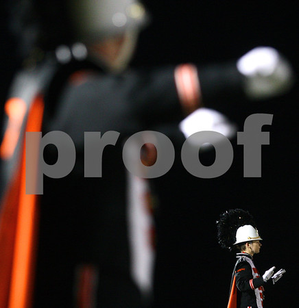 Kyle Bursaw – kbursaw@shawmedia.com<br /> <br /> Claire Spahn, a drum major for the DeKalb marching band (bottom right), conducts the band before the start of the game against Yorkville at DeKalb High School on Friday, Oct. 12, 2012.