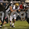 Rob Winner – rwinner@shawmedia.com<br /> <br /> Sycamore quarterback Devin Mottet (center) is sacked by Kaneland's Justin Diddell (53) and Jaumaureo Phillips (74) during the second quarter in Maple Park Friday, Oct. 12, 2012.