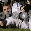 Rob Winner – rwinner@shawmedia.com<br /> <br /> Sycamore running back Austin Culton (1) loses his helmet after a carry during the first quarter in Maple Park Friday, Oct. 12, 2012.