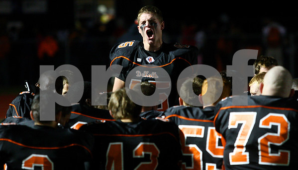 Kyle Bursaw – kbursaw@shawmedia.com<br /> <br /> Wide receiver Ryan Metzker gets the Barbs pumped up before the game against Yorkville at DeKalb High School on Friday, Oct. 12, 2012.