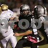 Rob Winner – rwinner@shawmedia.com<br /> <br /> Kaneland quarterback Tyler Carlson (10) carries the ball during the first quarter in Maple Park Friday, Oct. 12, 2012.