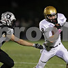 Rob Winner – rwinner@shawmedia.com<br /> <br /> Kaneland linebacker Dylan Nauert (20) chases after Sycamore wide receiver Ben Niemann (8) during the first quarter in Maple Park Friday, Oct. 12, 2012.