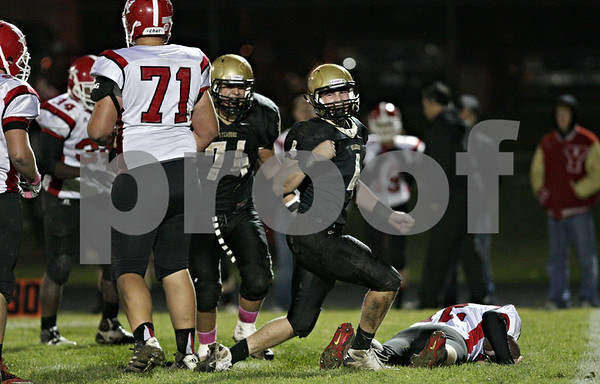 Rob Winner – rwinner@shawmedia.com<br /> <br /> Sycamore linebacker Brett Weaver (4) reacts after sacking Yorkville quarterback Jake Anton (right) during the second quarter in Sycamore Friday, Oct. 19, 2012.