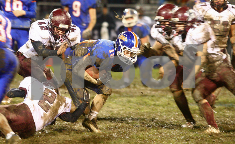 Kyle Bursaw – kbursaw@shawmedia.com<br /> <br /> Marengo defensive back Edilio Andrade (2) trips up Genoa-Kingston running back Eli Thurlby in the second quarter of the game at Genoa-Kingston High School on Friday, Oct. 19, 2012.
