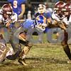 Kyle Bursaw – kbursaw@shawmedia.com<br /> <br /> Marengo defensive back Edilio Andrade (2) trips up Genoa-Kingston running back Eli Thurlby in the second quarter of the game at Genoa-Kingston High School on Friday, Oct. 19, 2012.