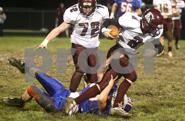 Kyle Bursaw – kbursaw@shawmedia.com<br /> <br /> Genoa-Kingston defensive lineman Lane Bankson (55) brings down Marengo quarterback Ethan Walsweer (8) in the first quarter of the game at Genoa-Kingston High School on Friday, Oct. 19, 2012.