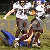 Kyle Bursaw – kbursaw@shawmedia.com<br /> <br /> Genoa-Kingston defensive lineman Lane Bankson (55) brings down Marengo quarterback Ethan Walsweer (8) in the first quarter of the game at Genoa-Kingston High School on Friday, Oct. 19, 2012.